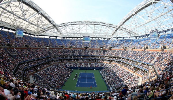 NEW YORK, NY - SEPTEMBER 02: Fans watch from Arthur Ashe Stadium as Serena Williams of the United States plays against Kiki Bertens of the Netherlands during their Women's Singles Second Round match on Day Three of the 2015 US Open at the USTA Billi...