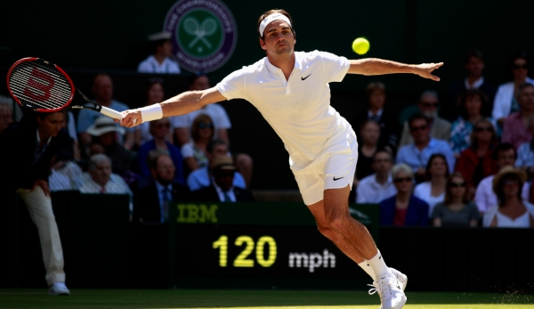 LONDON, ENGLAND - JULY 06: Roger Federer of Switzerland plays a forehand during the Men's Singles Quarter Finals match against Marin Cilic of Croatia on day nine of the Wimbledon Lawn Tennis Championships at the All England Lawn Tennis and Croquet C...