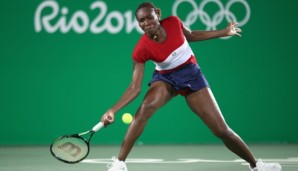 RIO DE JANEIRO, BRAZIL - AUGUST 06: Venus Williams of USA in action against Kirsten Flipkens of Belgium in the women's first round on Day 1 of the Rio 2016 Olympic Games at the Olympic Tennis Centre on August 6, 2016 in Rio de Janeiro, Brazil. (Pho...