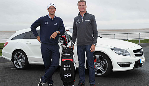 Adam Scott (l.) und David Coulthard vor dem neuen Mercedes-Benz CLS 63 AMG Shooting Brake