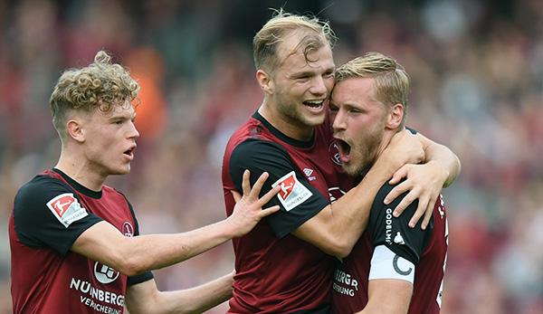 Hanno Behrens, Johannes Geis und Robin Hack wollen mit dem 1. FC Nürnberg auch gegen den Karlsruher SC jubeln und wichtige Punkte im Kampf um den Klassenerhalt einfahren.