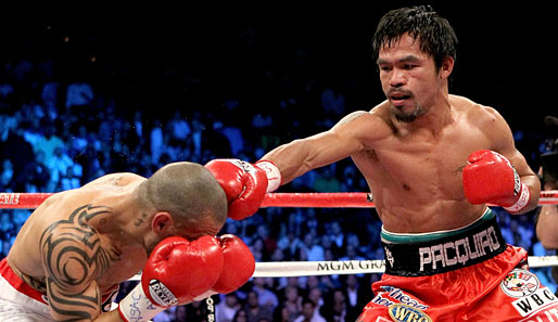 Manny Pacquiao (r.) besiegte im Miguel Cotto in Las Vegas
