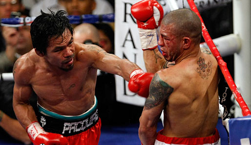 Am 14. November 2009 besiegte Manny Pacquiao (l.) Miguel Cotto durch technischen K.o.