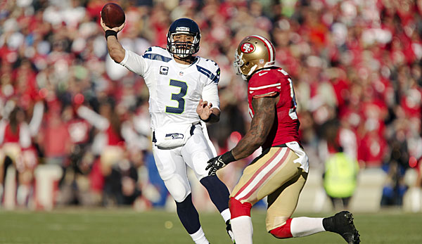 Russel Wilson (l.) bleibt doch in Seattle