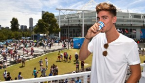 MELBOURNE, AUSTRALIA - JANUARY 19: Thanasi Kokkinakis of Australia enjoys a short black coffe at Lavazza on Grand Slam Oval during day two of the 2016 Australian Open at Melbourne Park on January 19, 2016 in Melbourne, Australia. (Photo by Vince C...