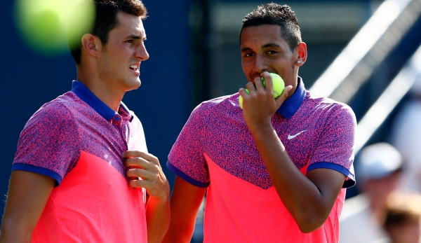 NEW YORK, NY - AUGUST 27: Nick Kyrgios and Bernard Tomic of Australia play in a doubles match on Day Three of the 2014 US Open at the USTA Billie Jean King National Tennis Center on August 27, 2014 in the Flushing neighborhood of the Queens borough...