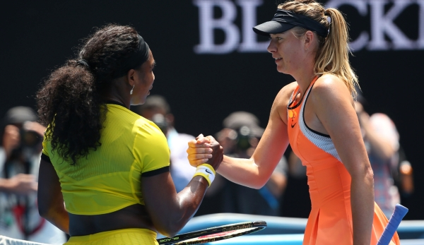 MELBOURNE, AUSTRALIA - JANUARY 26: Maria Sharapova of Russia congratulates Serena Williams of the United States on winning their quarter final match during day nine of the 2016 Australian Open at Melbourne Park on January 26, 2016 in Melbourne, Aust...