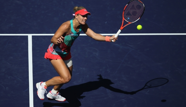 INDIAN WELLS, CA - MARCH 12: Angelique Kerber of Germany returns a shot against Denisa Allertova of Czech Republic during the BNP Paribas Open at the Indian Wells Tennis Garden on March 11 at Indian Wells Tennis Garden on March 12, 2016 in Indian W...