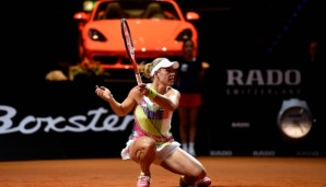 STUTTGART, GERMANY - APRIL 22: Angelique Kerber of Germany plays a forehand in her match against Carla Suarez Navarro of Spain during Day 5 of the Porsche Tennis Grand Prix at Porsche-Arena on April 22, 2016 in Stuttgart, Germany. (Photo by Dennis ...