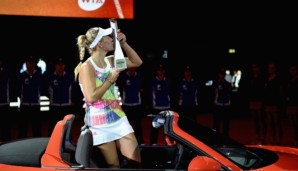 STUTTGART, GERMANY - APRIL 24: Angelique Kerber of Germany celebrates with the trophy after the singles final match against Laura Siegemund of Germany on Day 7 of the Porsche Tennis Grand Prix at Porsche-Arena on April 24, 2016 in Stuttgart, Germany...