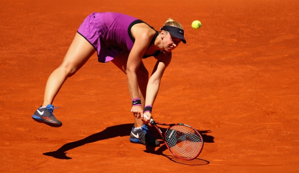 MADRID, SPAIN - MAY 03: Sabine Lisicki of Germany stretches to play a backhand against Carla Suarez Navarro of Spain in their second round match during day four of the Mutua Madrid Open tennis tournament at the Caja Magica on May 03, 2016 in Madrid,...