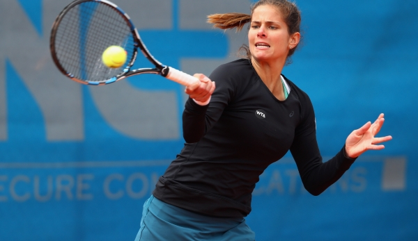 NUREMBERG, GERMANY - MAY 17: Julia Goerges of Germany returns the ball to Cristina Dinu of Romania during day four of the Nuernberger Versicherungscup 2016 on May 17, 2016 in Nuremberg, Germany. (Photo by Alex Grimm/Bongarts/Getty Images)