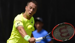 STUTTGART, GERMANY - JUNE 12: Philipp Kohlschreiber of Germany returns during his match against Geal Monfils of France on day seven of Mercedes Cup 2015 on June 12, 2015 in Stuttgart, Germany. (Photo by Daniel Kopatsch/Bongarts/Getty Images)