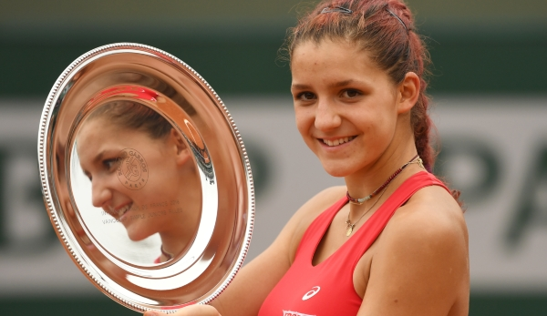 PARIS, FRANCE - JUNE 05: Champion Rebeka Masarova of Switzerland poses with the trophy following her victory during the Girls Singles final match against Amanda Anisimova of the United States on day fifteen of the 2016 French Open at Roland Garros o...