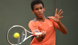 PARIS, FRANCE - JUNE 05: Felix Auger Aliassime of canada hits a forehand during the Boys Singles final match against Geoffrey Blancaneaux of France on day fifteen of the 2016 French Open at Roland Garros on June 5, 2016 in Paris, France. (Photo by ...