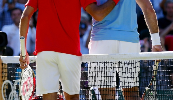 LONDON, ENGLAND - AUGUST 03: (L-R) Roger Federer of Switzerland is congratulated by Juan Martin Del Potro of Argentina after his 4-6, 7-6, 19-17 win in the Semifinal of Men's Singles Tennis on Day 7 of the London 2012 Olympic Games at Wimbledon on A...
