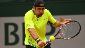 PARIS, FRANCE - MAY 22: Benjamin Becker of Germany hits a backhand during the Men's Singles first round match against Andrey Kuznetsov of Russia on day one of the 2016 French Open at Roland Garros on May 22, 2016 in Paris, France. (Photo by Dennis ...