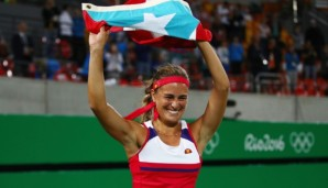 RIO DE JANEIRO, BRAZIL - AUGUST 13: Monica Puig of Puerto Rico reacts after defeating Angelique Kerber of Germany in the Women's Singles Gold Medal Match on Day 8 of the Rio 2016 Olympic Games at the Olympic Tennis Centre on August 13, 2016 in Rio d...