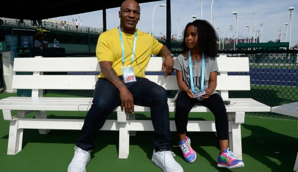 INDIAN WELLS, CA - MARCH 13: Mike Tyson and daughter Milan Tyson sit on the practice courts during day seven of the BNP Paribas Open at Indian Wells Tennis Garden on March 13, 2016 in Indian Wells, California. (Photo by Kevork Djansezian/Getty Imag...
