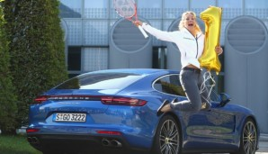 MUNICH, GERMANY - SEPTEMBER 13: Angelique Kerber of Germany poses in front of a new Porsche Panamera Turbo after returning as new Tennis World number One and winner of the US Open at Munich Airport on September 13, 2016 in Munich, Germany. (Photo ...